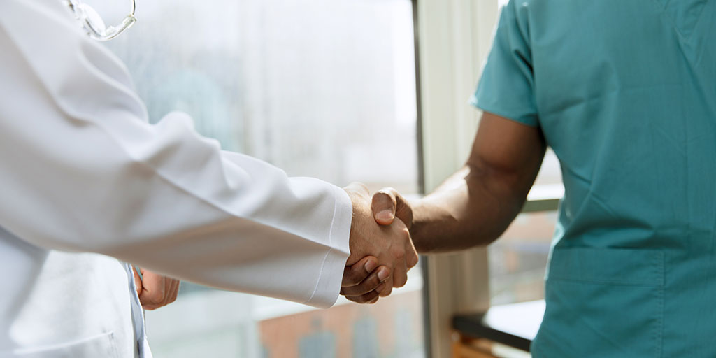 Physicians shaking hands
