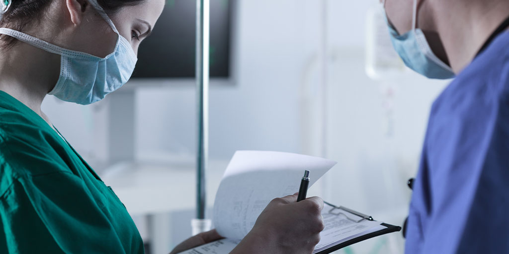 Doctor checking documents